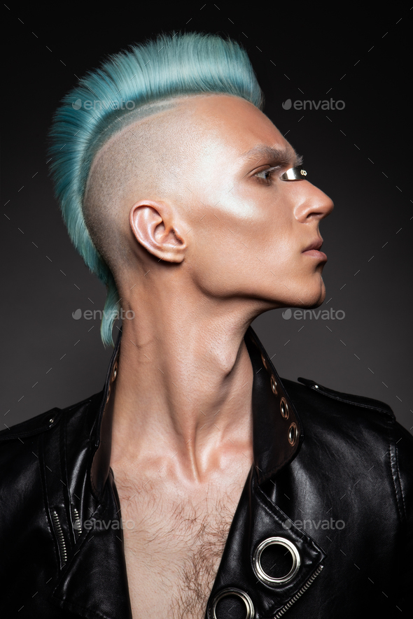 Profile of a handsome man with blue hair - Stock Photo - Images