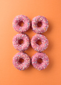 decorated pink donuts on color background - PhotoDune Item for Sale
