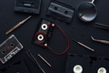 Flat lay audio and video cassette parts on dark background - PhotoDune Item for Sale