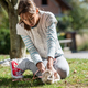 Young girl playing with her pet rabbit - PhotoDune Item for Sale