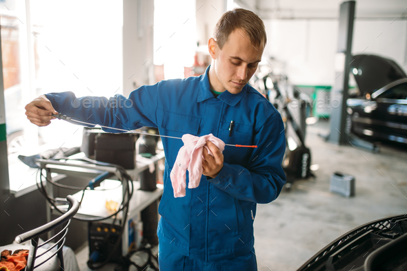 Male technician works with car engine - Stock Photo - Images