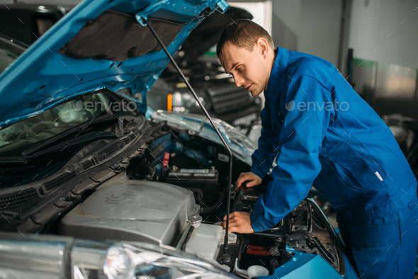 Mechanic repairs car engine, motor diagnostic - Stock Photo - Images