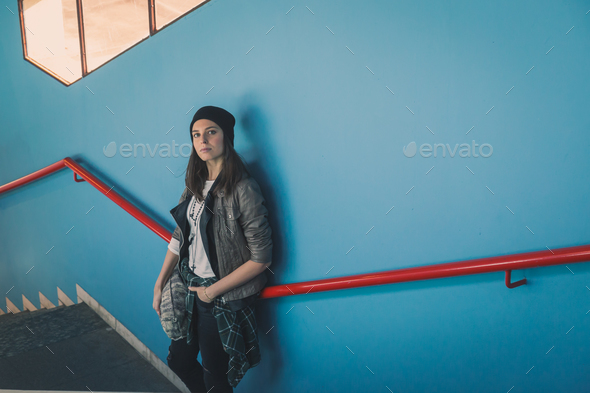 Pretty girl posing in a metro station - Stock Photo - Images