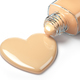 Liquid makeup foundation cream in form of the heart symbol and g - PhotoDune Item for Sale