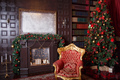 Christmas decor in royal living room with a vintage armchair, fireplace - PhotoDune Item for Sale