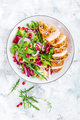 Grilled chicken breast, fillet and fresh vegetable leafy salad with arugula and pomegranate - PhotoDune Item for Sale