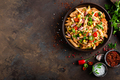Spicy pasta penne bolognese with vegetables, beans, chili and cheese in tomato sauce - PhotoDune Item for Sale