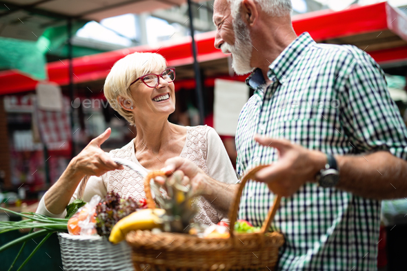 Senior shopping couple with basket on the market. Healthy diet - Stock Photo - Images