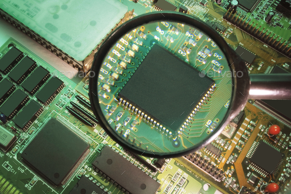 Magnifying Glass on Circuit Board - Stock Photo - Images