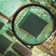 Magnifying Glass on Circuit Board - PhotoDune Item for Sale