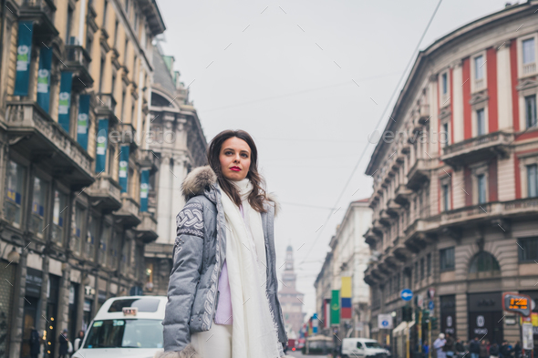 Beautiful young brunette posing in the city streets - Stock Photo - Images