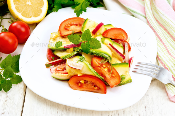 Salad with zucchini and vegetables on board - Stock Photo - Images