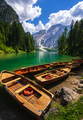 Wooden boat at lake Braies, Dolomites mountains, Italy - PhotoDune Item for Sale