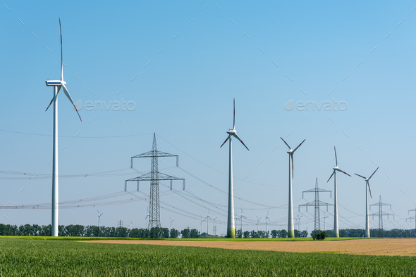 Overhead power lines and wind turbines  - Stock Photo - Images