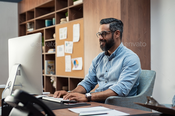 Creative man working on computer - Stock Photo - Images