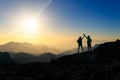 Couple hikers celebrating success concept in mountains - PhotoDune Item for Sale