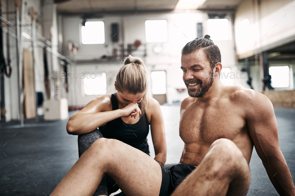 Fit people laughing while taking a break from working out - Stock Photo - Images