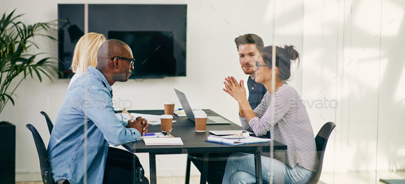 Diverse business colleagues having a meeting together in an office - Stock Photo - Images