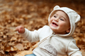 Cheerful baby in autumn forest - PhotoDune Item for Sale