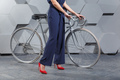 Fashionably dressed woman with bike - PhotoDune Item for Sale