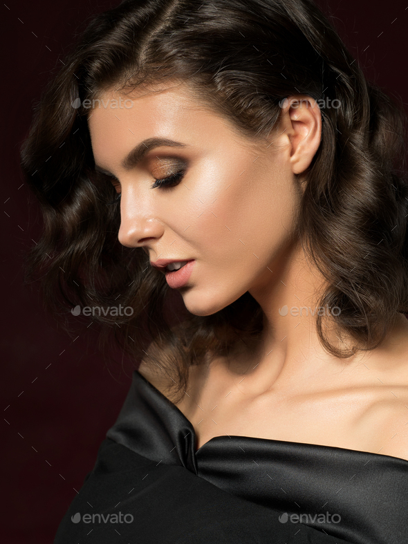 Young beautiful woman wearing black evening dress - Stock Photo - Images