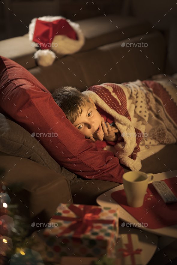 Boy waiting for Santa on Christmas eve - Stock Photo - Images