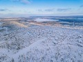 Aerial view of winter forest with frosty trees, rural road and village in Finland - PhotoDune Item for Sale
