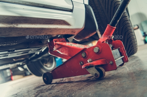 Floor Jack Car Lift Service - Stock Photo - Images