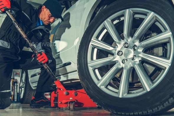 Mechanic with Floor Jack Lift - Stock Photo - Images