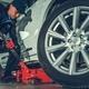 Mechanic with Floor Jack Lift - PhotoDune Item for Sale