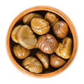 Cooked sweet chestnuts in wooden bowl over white - PhotoDune Item for Sale
