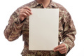 Young soldier holding a blank paper standing on white background - PhotoDune Item for Sale