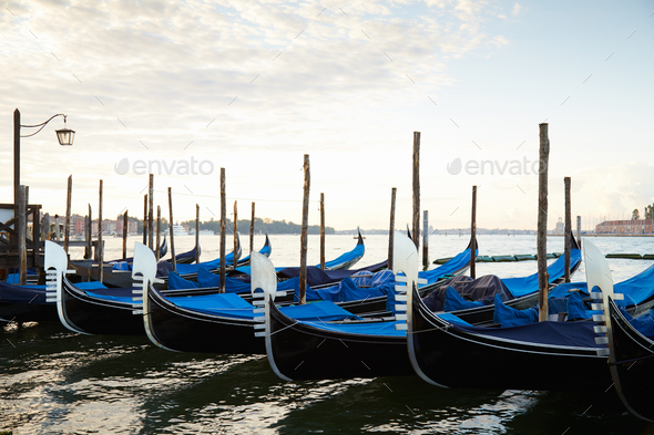 Gondola boats moored in Grand Canal in Venice, nobody - Stock Photo - Images