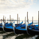 Gondola boats moored in Grand Canal in Venice, nobody - PhotoDune Item for Sale