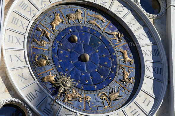 Golden zodiac astrological clock, sunlight and shadow - Stock Photo - Images