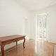 White room with wooden table in renovated apartment - PhotoDune Item for Sale