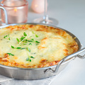 Cheesy scalloped potatoes or potato gratin in baking dish, holid - PhotoDune Item for Sale