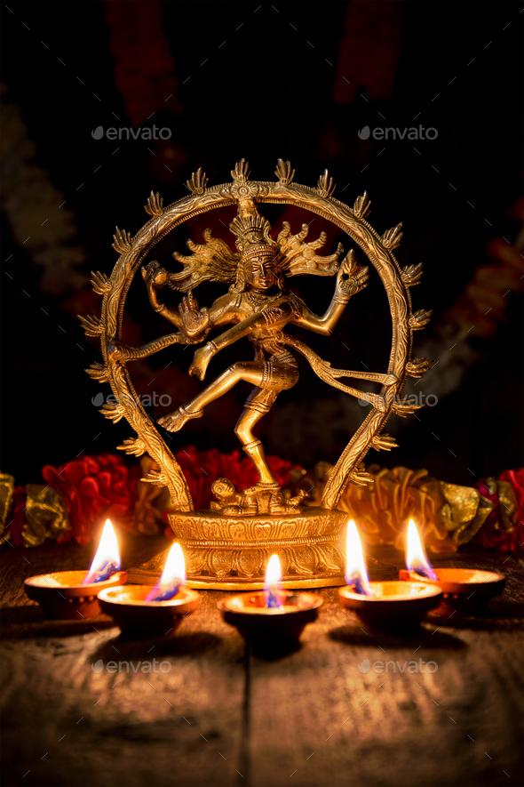 Shiva Nataraja with Diwali lights - Stock Photo - Images