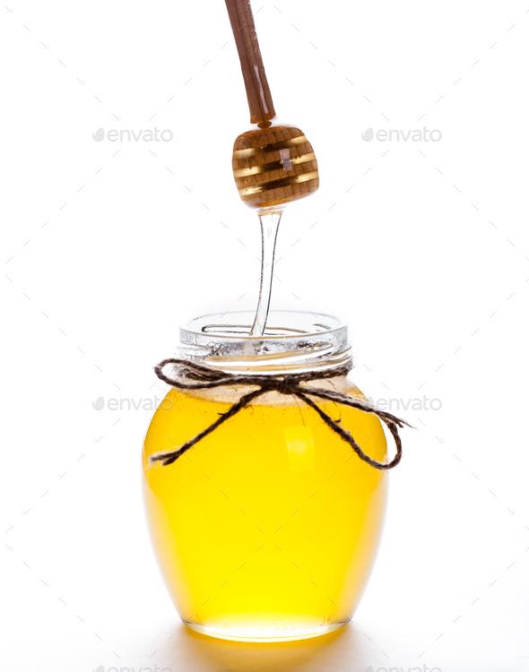 Full honey pot and honey stick - Stock Photo - Images