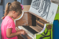 Cute little girl playing on the piano - PhotoDune Item for Sale