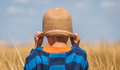 Boy with a straw hat in a countryside - PhotoDune Item for Sale