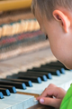Little boy playing on the piano - PhotoDune Item for Sale