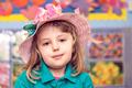 Cute little girl wearing pink wicker hat - PhotoDune Item for Sale