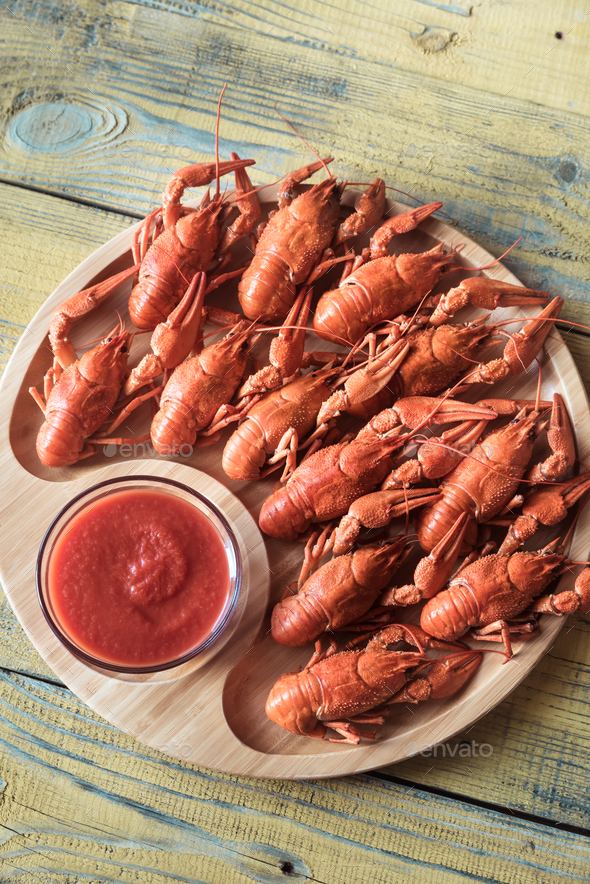 Dish of boiled crayfish with sauce - Stock Photo - Images