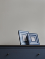 two wooden picture frame on blue chest of drawers - PhotoDune Item for Sale