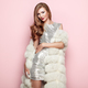 Fashion portrait young woman in white fur coat - PhotoDune Item for Sale