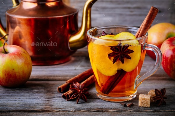 Hot mulled apple cider drink with cinnamon stick, cloves and anise - Stock Photo - Images