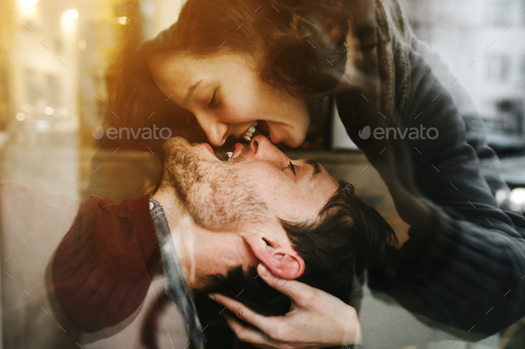 Vintage couple . Girl kiss her boyfriend from above  .Coffee sh - Stock Photo - Images