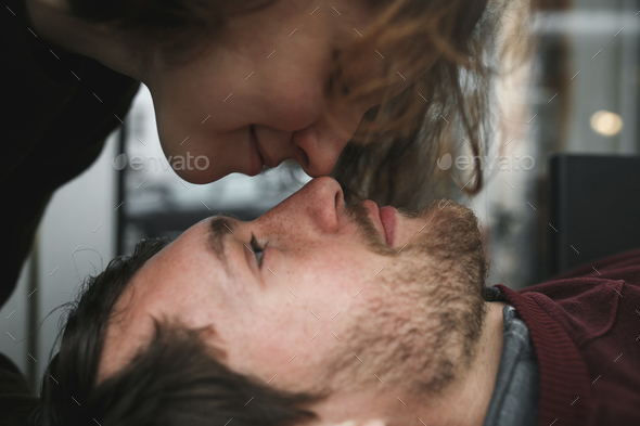 Vintage couple . Girl kiss her boyfriend from above  .Coffee sho - Stock Photo - Images