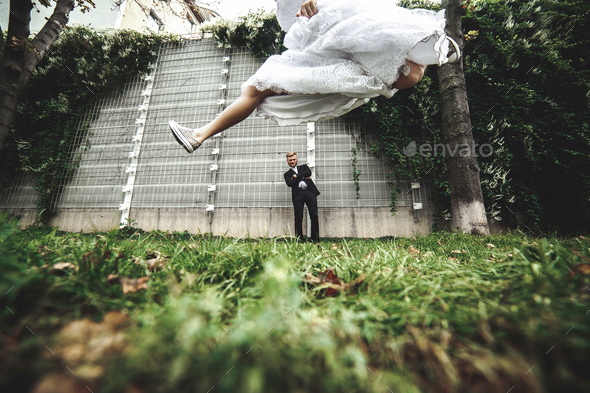 Wedding couple on a walk in the city - Stock Photo - Images